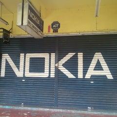 Photo taken at Triple Communication by Ricky K. on 10/21/2012