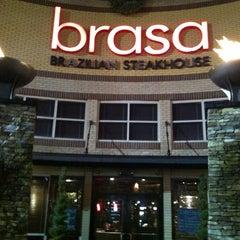 Photo taken at Brasa Brazilian Steakhouse by Erica S. on 12/16/2012