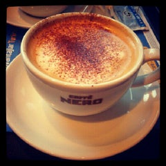 Photo taken at Caffè Nero by Neslihan S. on 10/26/2012