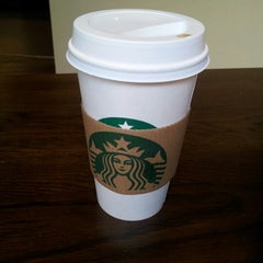 Photo taken at Starbucks by Jayd L. on 10/12/2012
