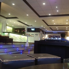 Photo taken at Wave Seafood Kitchen by Oleg S. on 10/3/2012