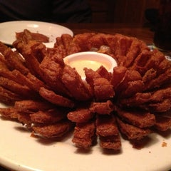 Photo taken at Outback Steakhouse by Andrew R. on 1/3/2013
