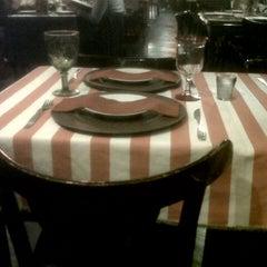 Photo taken at VeintiCinco Restaurant by Robert M. on 5/24/2014