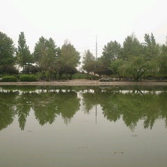 Photo taken at Laguna Parque de Los Reyes by Urso O. on 1/19/2013