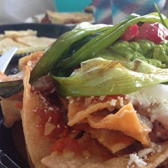 Photo taken at La Super-Rica Taqueria by Lindsay M. on 7/1/2013