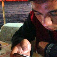 Photo taken at Pantai Penimbangan by wiwin o. on 6/21/2014