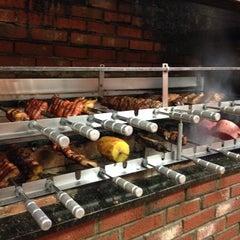 Photo taken at Pampas Brazilian Steak House by Petrona Z. on 7/30/2014