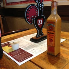 Photo taken at Nando's by Nep on 7/12/2013