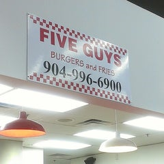 Photo taken at Five Guys by Aisha B. on 5/3/2013
