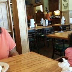 Photo taken at Rooster's Café by Dwayne W. on 6/14/2014