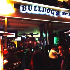 Photo taken at Bulldog's Bar & Grill by Hideo Y. on 3/22/2015