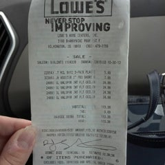 Photo taken at Lowe's Home Improvement by Paige S. on 10/30/2012