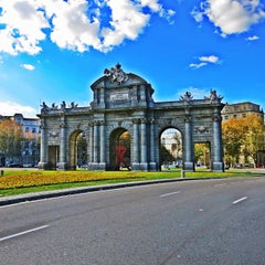 Photo taken at Puerta de Alcalá by Bryant B. on 12/9/2012