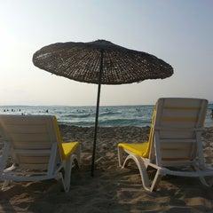 Photo taken at Ilıca Plajı by Egeden T. on 6/30/2013