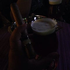 Photo taken at Churchill's Cigar Lounge by Luis R. on 5/3/2014