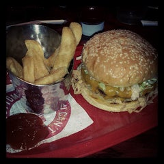 Photo taken at Red Robin Gourmet Burgers by Jenifer S. on 7/18/2013