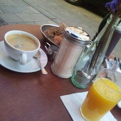 Photo taken at Café Puck by Naty U. on 10/3/2012