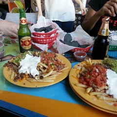 Photo taken at Taqueria Los Coyotes by Sarah S. on 7/21/2013