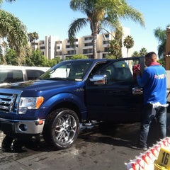Photo taken at National City Car Wash by Jenil S. on 9/27/2013
