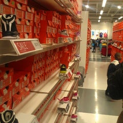 Photo taken at Nike Factory Store by Eyvette L. on 9/21/2012