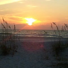 Photo taken at Coquina Beach by Chrissy H. on 11/24/2012