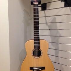 Photo taken at Gruhn Guitars by Sarah H. on 10/27/2014