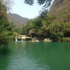 Photo taken at Cascada Micos by Dulce on 5/4/2013