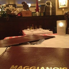 Photo taken at Maggiano's Little Italy by Rosa L. on 12/8/2012