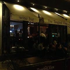 Photo taken at The Tangled Vine Wine Bar & Kitchen by Anton B. on 6/13/2013