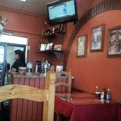 Photo taken at The Wet Burrito by Carlos T. on 6/17/2014