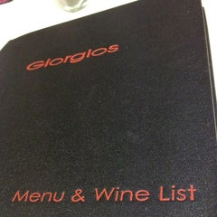 Photo taken at Giorgios Restaurant by PuiFai K. on 8/31/2013