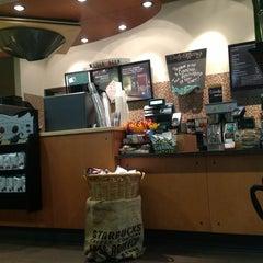 Photo taken at Starbucks by Мария К. on 2/24/2013