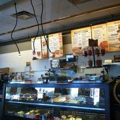 Photo taken at Einstein Bros Bagels by Diaz A. on 10/4/2012