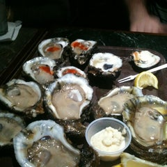 Photo taken at Cooter Brown's Tavern & Oyster Bar by Ashley R. on 11/24/2012