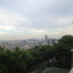 Photo taken at 낙산공원 (Naksan Park) by Peter J. on 6/16/2013