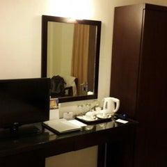 Photo taken at Grand Zuri Hotel by Kresna K. on 8/29/2013