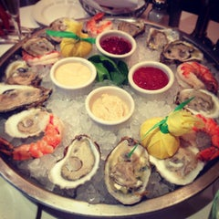 Photo taken at The Capital Grille by Sze L. on 12/14/2012