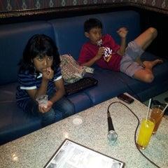Photo taken at Music World Karaoke by Fajriah I. on 10/20/2012