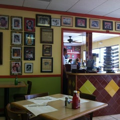Photo taken at Azucar Restaurant & Bakery by Bill B. on 3/20/2013