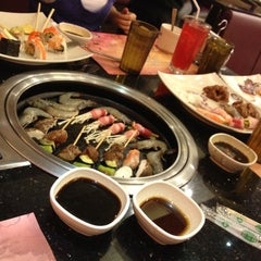 Photo taken at YakiMix Sushi & Smokeless Grill by Cathy on 12/16/2012