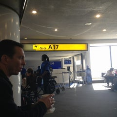 Photo taken at Gate A17 by Charlie G. on 1/10/2013