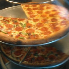 Photo taken at A Pizza Mart by Jay G. on 12/23/2011