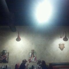 Photo taken at Mi Familia by Tim L. on 12/23/2011