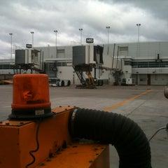 Photo taken at Gate M15 by Brandon G. on 9/30/2011