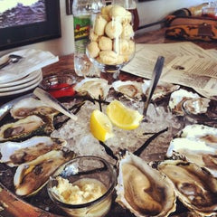 Photo taken at Henlopen City Oyster House by Brian S. on 5/25/2012