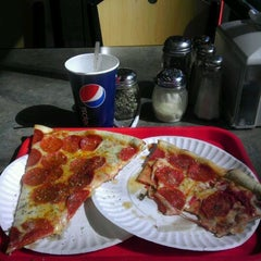 Photo taken at Dolce Carini Pizza by Robert W. on 3/10/2012