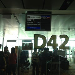 Photo taken at Gate D42 by Simon T. on 12/14/2012