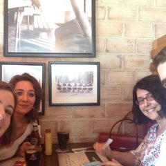 Photo taken at Foster's Hollywood by Elena C. on 7/23/2014