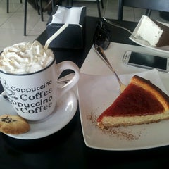 Photo taken at Cafe De La Avenida by David C. on 10/7/2013