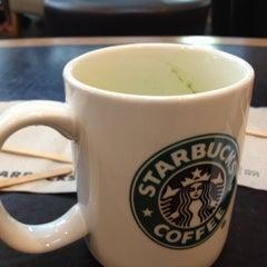 Photo taken at Starbucks by Tang J. on 12/1/2012